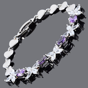 RIZILIA Blossom Tennis Bracelet & Oval Cut CZ [3 Colors Available] in White Gold Plated, 7""