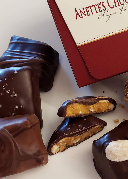 Close up image of chocolate pieces with a 6 piece box