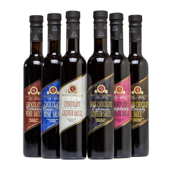 Assortment of 6 Tall bottles of Chocolate sauces