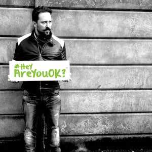 Black and White image of Paul AKA Allotment Junkie holding a sign #HeyAreYouOK