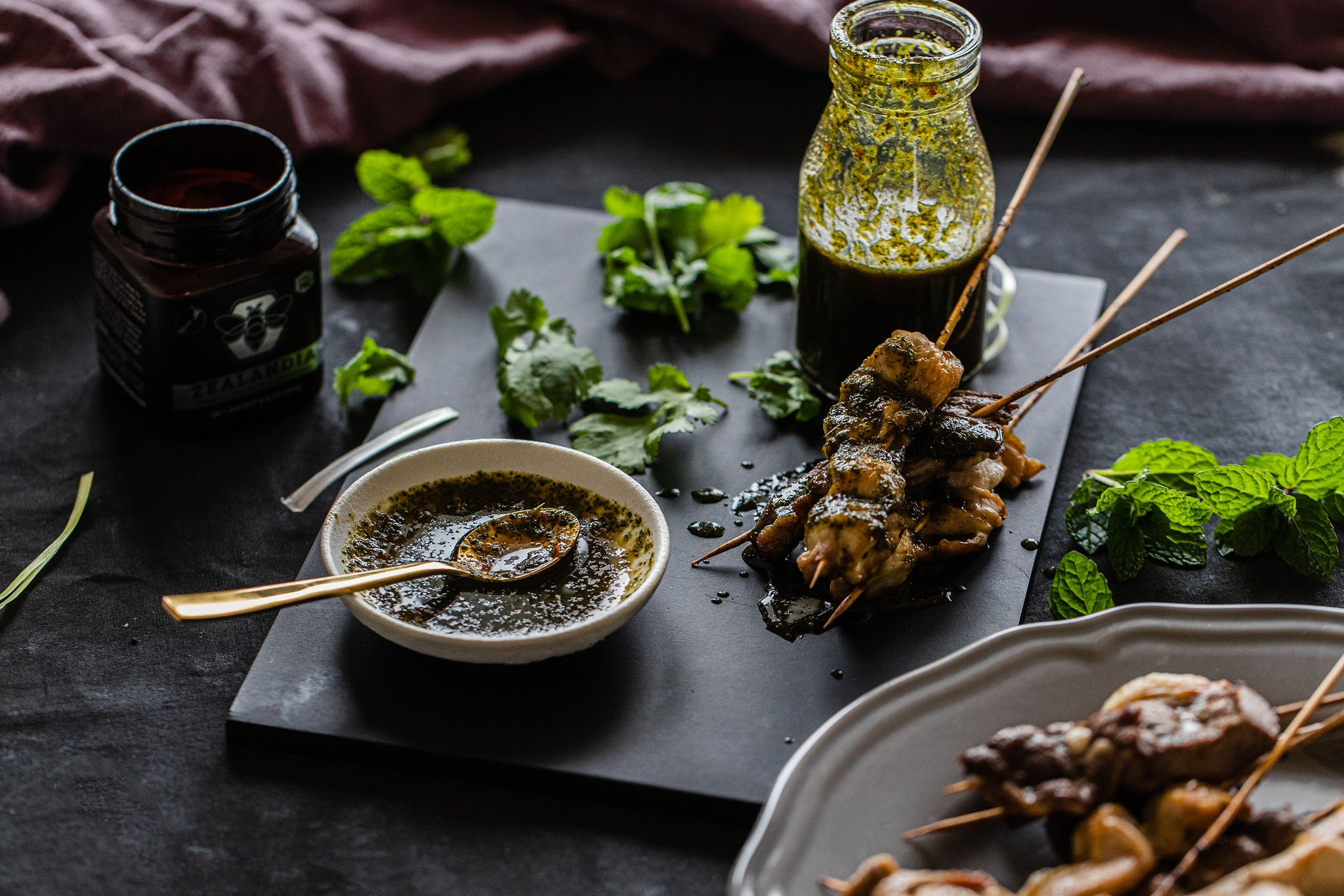 Manuka Honey with sate skewers