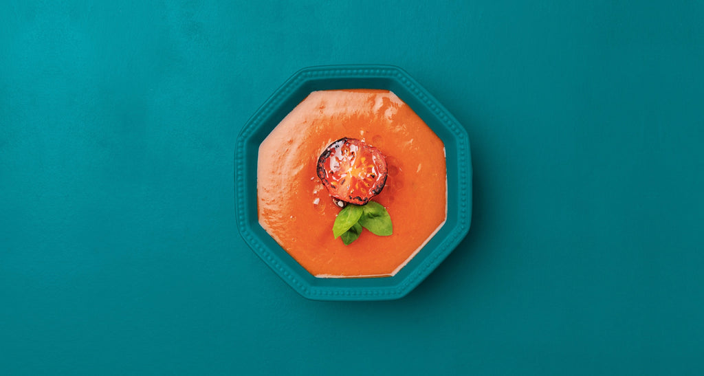 Whatif foods tomato soup with a tomato and basil leaf