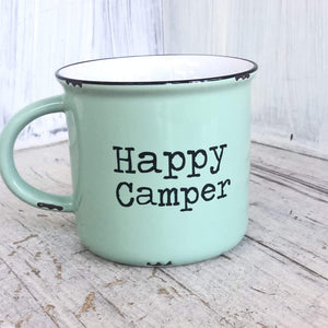 Mint green camp style ceramic mug that says Happy Camper.