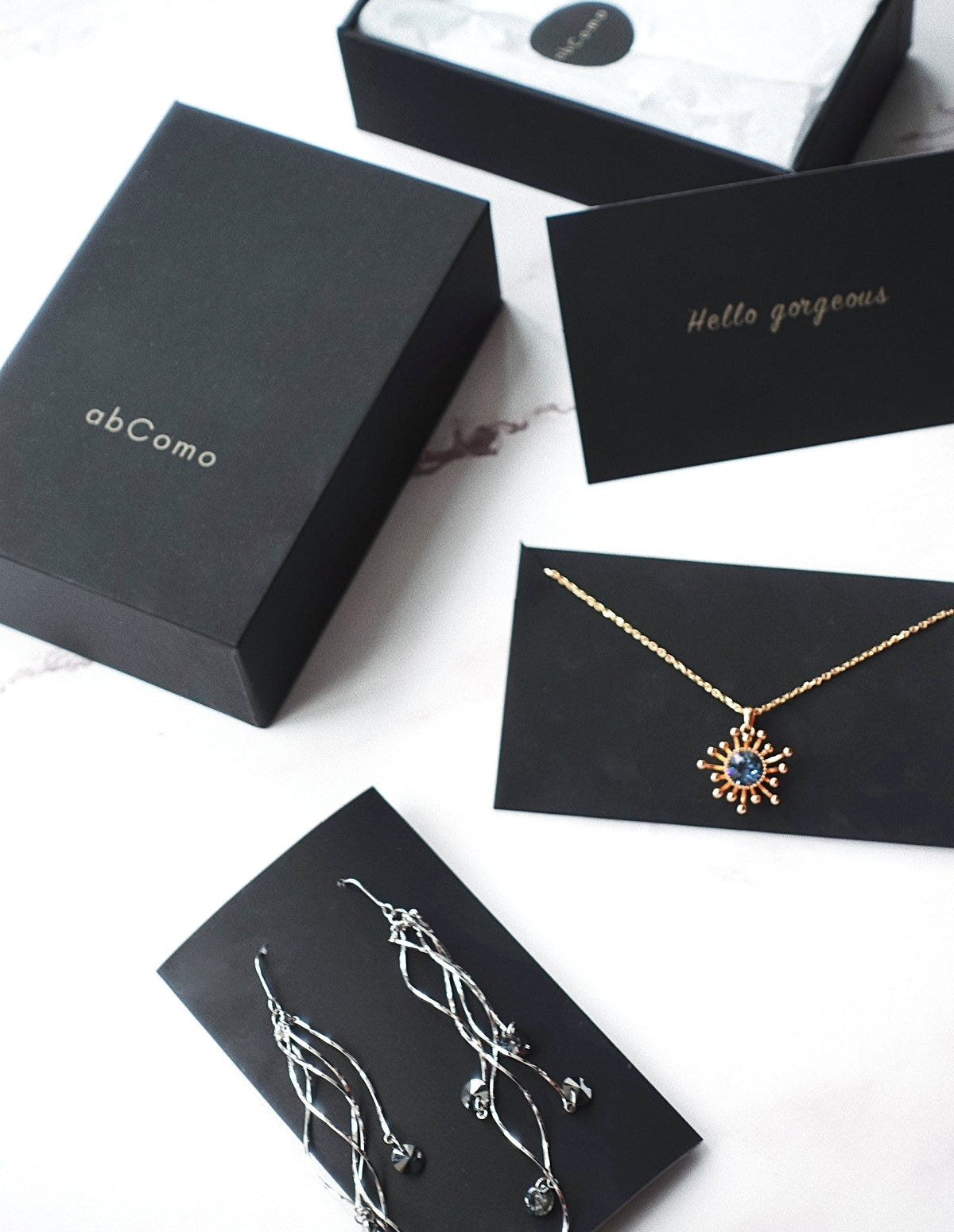 abComo sustainable packaging Swarovski necklace earrings silver gold