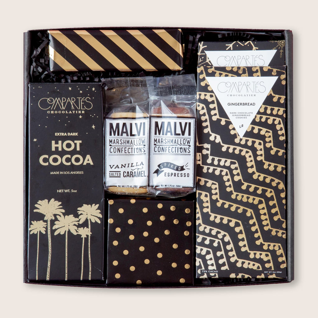Stunning black-and-gold holiday gift set filled with artisanal treats in gorgeous, modern packaging.