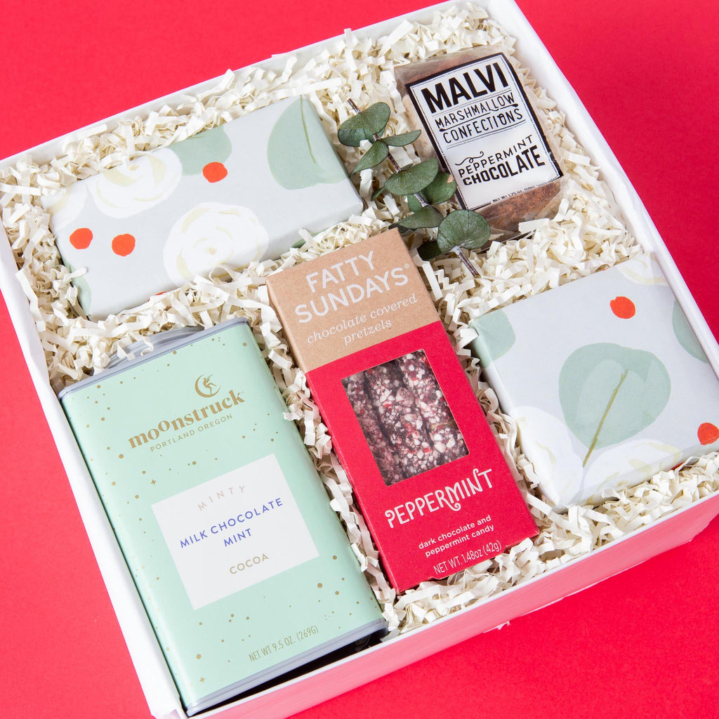 Chocolate and peppermint themed hoilday gift box filled with decadent chocolate and peppermint flavored treats.