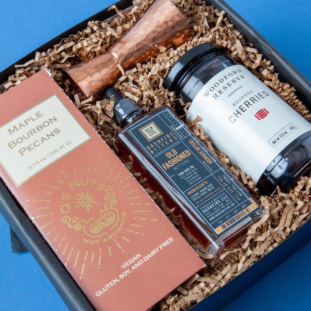 Premium Old Fashioned gift set featuring bitters, cherries and copper jigger.
