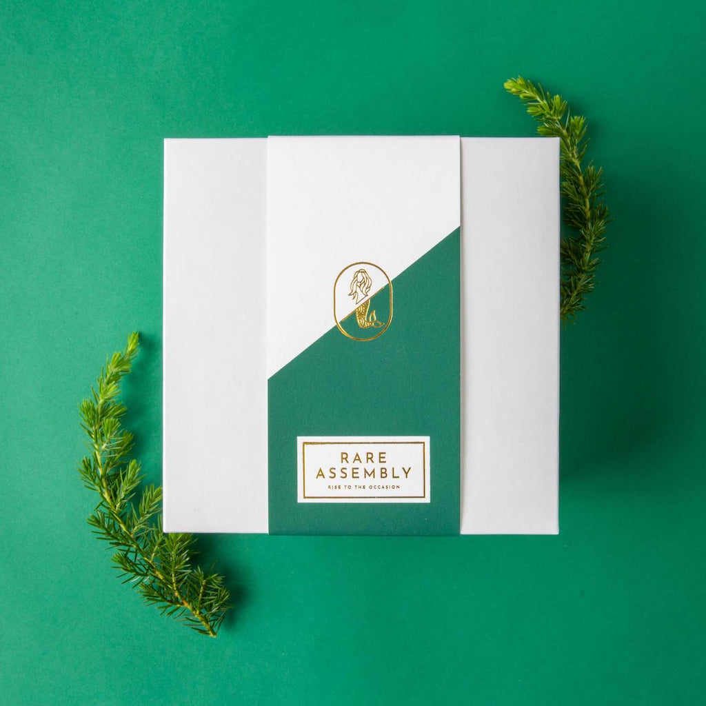 Evergreen colored holiday gift box packaging design by Rare Assembly.