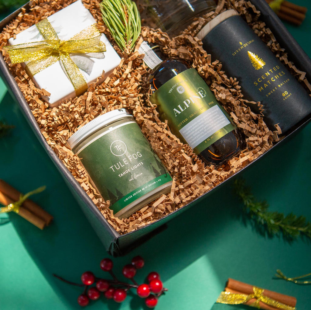 Sophisticated holiday gift set with an elegant pine theme, featuring drink mix and rocks glass. Great Christmas gift for him.