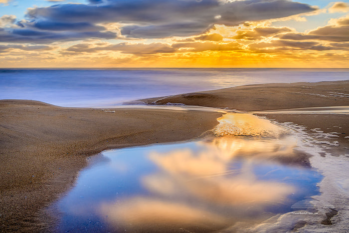 Calm Reflection at Kitty Hawk beach on the Outer Banks of NC.