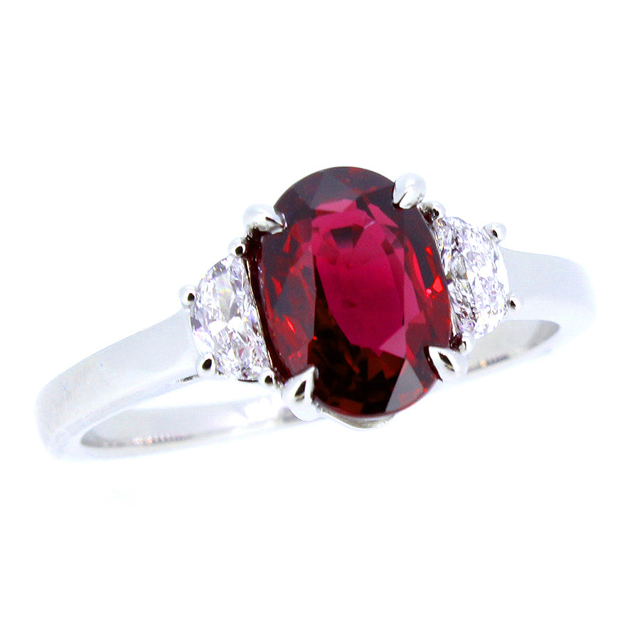 Platinum three stone ring with 2.04ct oval ruby, vivid red, ...