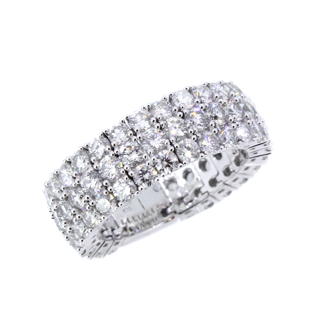 18KT white gold flexible band with 4.09ctw round diamonds, H...