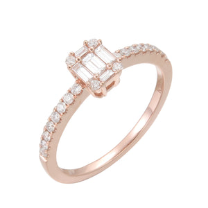 18KT rose gold ring with 0.31ctw round and baguette diamonds...