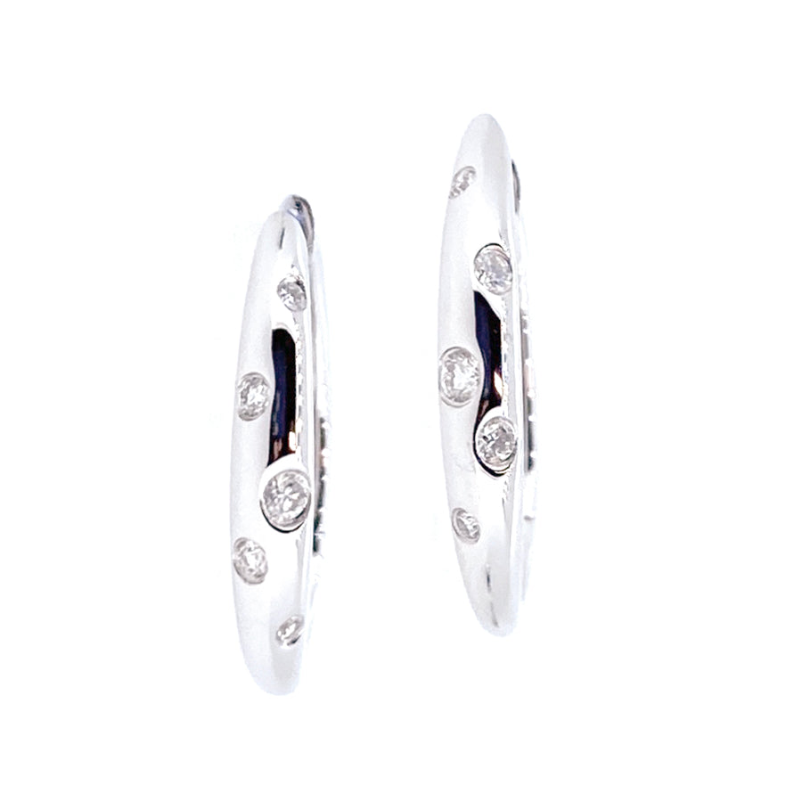 18KT white gold hoop earrings with 0.13ctw round diamonds, G...