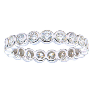 18KT white gold bezel set eternity band with 1.18ctw round d...