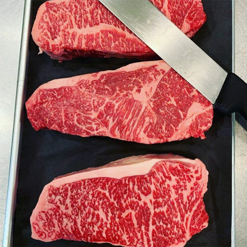 Rosewood Gold NY Strip Steaks 16 lbs - Hardie's Direct, Houston TX