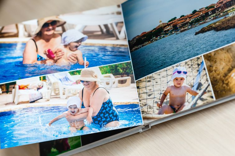 Personalized photo memory book with pictures of grandma at pool with grandson