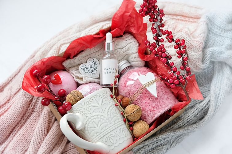 Personalized gift basket with wellness products, bath bombs, and mugs