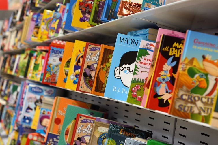 Metal bookshelves filled with recordable storybooks