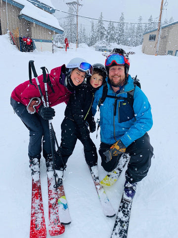 Family of three skiing