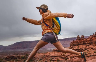 Cotopaxi Luzon - woman running with backpack on