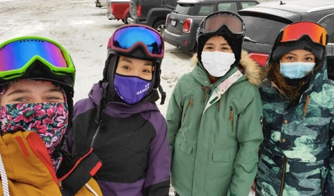 four snowboarders