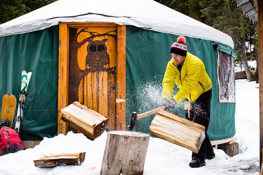 Chopping wood outside a yurt