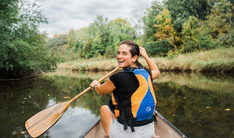 Smiling person canoeing
