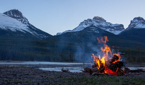 campfire in front of mountaines