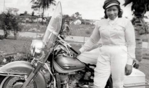 woman next to motorcycle
