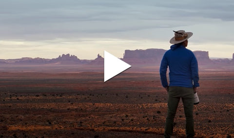 Man looking out over desert