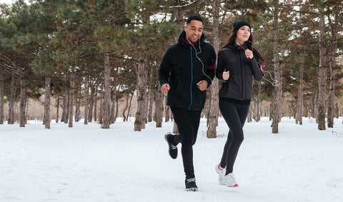 Man and woman running in the snow