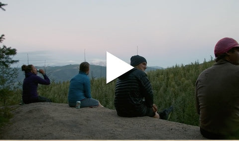 People sitting on mountain top