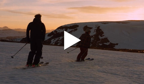 Two skiers at sunset