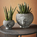 Grey tone face pot