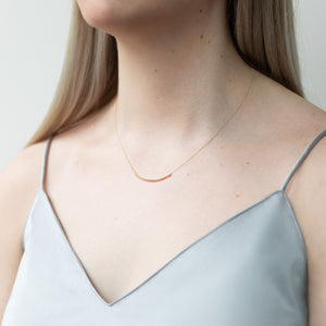 Curved bar necklace, silver & gold