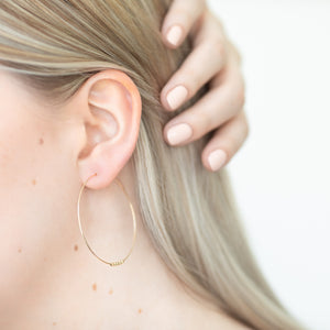Large Spheres hoop earrings, gold