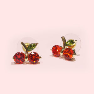 Looking for the perfect accessory to compliment a tee covered in fruit? We suggest adding even more fruit to your look with these lovely cherry earrings. The sweetest way to brighten up any outfit.