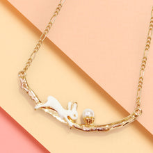 Load image into Gallery viewer, Pop Cuties' hand-enameled bunny pendant necklace showcases a dainty bunny with faux pearl cake. This little bunny with cake sits patiently on branch while you carry him around with you all day!