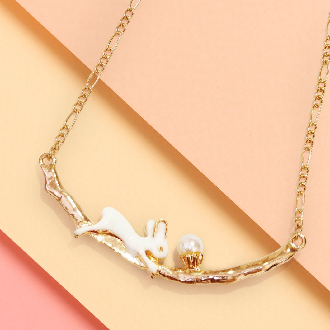 Pop Cuties' hand-enameled bunny pendant necklace showcases a dainty bunny with faux pearl cake. This little bunny with cake sits patiently on branch while you carry him around with you all day!