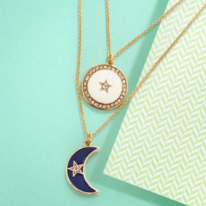 The Crescent Moon & Star is one of our world's most ancient symbols, combining powerful icons joining man and woman. Crystal star twinkle in a blue enamel half crescent moon. Ivory enamel full crescent moon embrace crystal twinkle star.  Brighten up your day! Wear this stunning and unique necklace, this necklace stack is relaxed styling you can wear immediately.