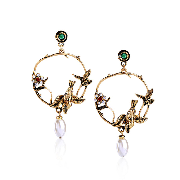 Description:  These earrings feature beautiful blooming wild roses, a pair of fairy-wrens in a romantic and poetic setting displaying faithful love, with a faux pearl embellished blossom.  This intricate, feminine and romantic design is perfect for day to day wear.