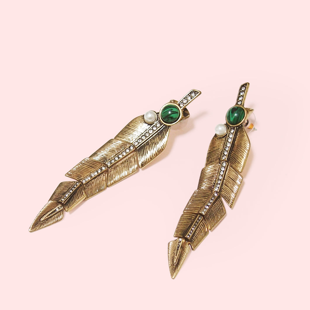 Feathers often symbolize hope, enlightenment, and the ability to rise obstacles.   This dangle earring set features long plume feathers finished in antique and vintage environmental zinc alloy to highlight the intricately detailed engraving. This earring set highlight and balance stylish and elegant with faux pearl, epoxy resin stone, and crystals.