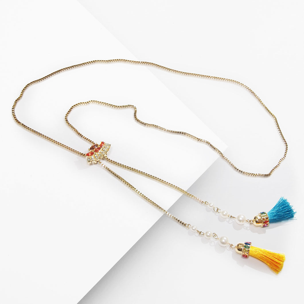 Show your unique style with this playful crystal encrusted and delicate chains of an elegant necklace finished with a pair of dainty tassels. This adjustable lariat pendant necklace is the perfect addition to any wardrobe all year long. Enjoy on-trend elegance with this delicate necklace in gold-tone finish.  It adds just the right amount of sparkle for any occasion. Use the special sliding closure to adjust the length of the necklace, from a choker to a longer style, and play with different effects.