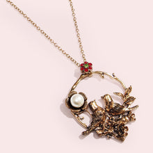 Load image into Gallery viewer, This necklace features beautiful blooming wild roses, a pair of fairy-wrens in a romantic and poetic setting displaying faithful love, with a faux pearl embellished flower and crystal-embellished blossom.  This intricate, feminine and romantic design is perfect for day to day wear.