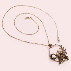 This necklace features beautiful blooming wild roses, a pair of fairy-wrens in a romantic and poetic setting displaying faithful love, with a faux pearl embellished flower and crystal-embellished blossom.  This intricate, feminine and romantic design is perfect for day to day wear.