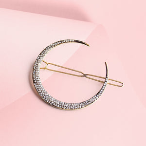 Sleek and sweet. This crescent moon hair clip is such a pretty way to elevate your outfits, whether it's a casual wear or party dress. This antique-gold tone crescent moon hair clip is set with twinkling crystals just like little stars following the moon's curve. Slide yours into loose tresses or a tousled updo.