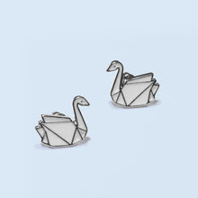 Load image into Gallery viewer, Swan symbolize love, grace, purity and beauty the understanding better spiritual evolution and maintain grace in the communication with other people.  A sparkle silver finish and enamel on environmental zinc alloy gives these art deco style earrings a contemporary, trendy and refine edge.