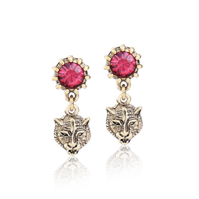 Designed to complement and enhance your chose outfit. Spice up your accessory collection now and fashion a fierce look when you frame your face with these antique-tone drop earrings, flaunting a sparkly tiger head with vibrant crystals.