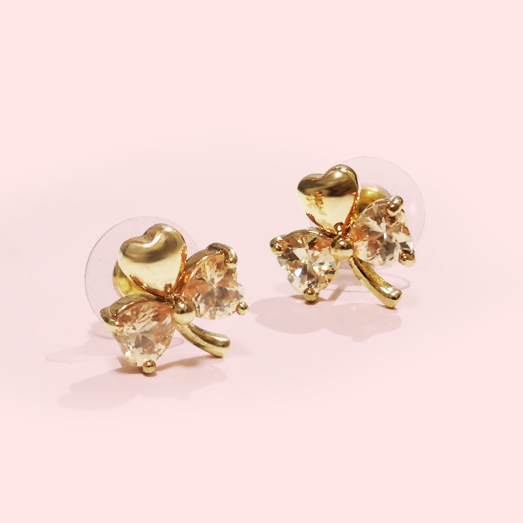 Luck will always be on your side in this pair of stud earrings celebrating the eternal symbol of Ireland.  The shamrock's heart-shaped leaves come to life with a dashing splash of champagne color, while its winding design gives a wink.